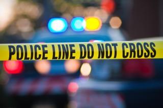 Image of police line via Shutterstock
