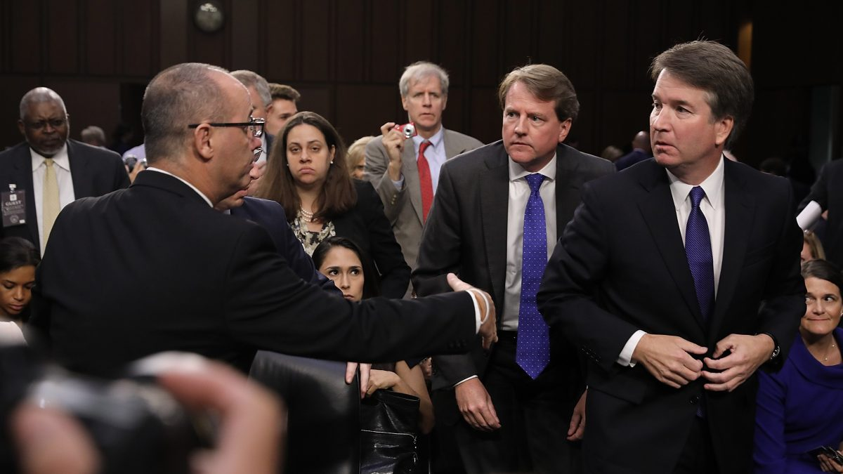 Fred Guttenberg (L), father of murdered Marjory Stoneman Douglas High School student Jamie Guttenberg, tries to shake the hand of Supreme Court nominee Judge Brett Kavanaugh as Kavanaugh appeared before the Senate Judiciary Committee during his Supreme Court confirmation hearing in the Hart Senate Office Building on Capitol Hill September 4, 2018 in Washington, DC.