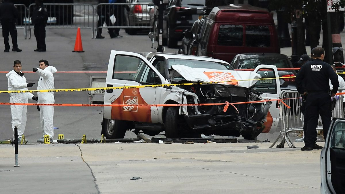 "Investigators work around the wreckage of a Home Depot pickup truck, a day after it was used in an terror attack, in New York on November 1, 2017. The pickup truck driver who plowed down a New York cycle path, killing eight people, in the city's worst attack since September 11, was associated with the Islamic State group but ""radicalized domestically,"" the state's governor said Wednesday. The driver, identified as Uzbek national named Sayfullo Saipov was shot by police in the stomach at the end of the rampage, but he was expected to survive."
