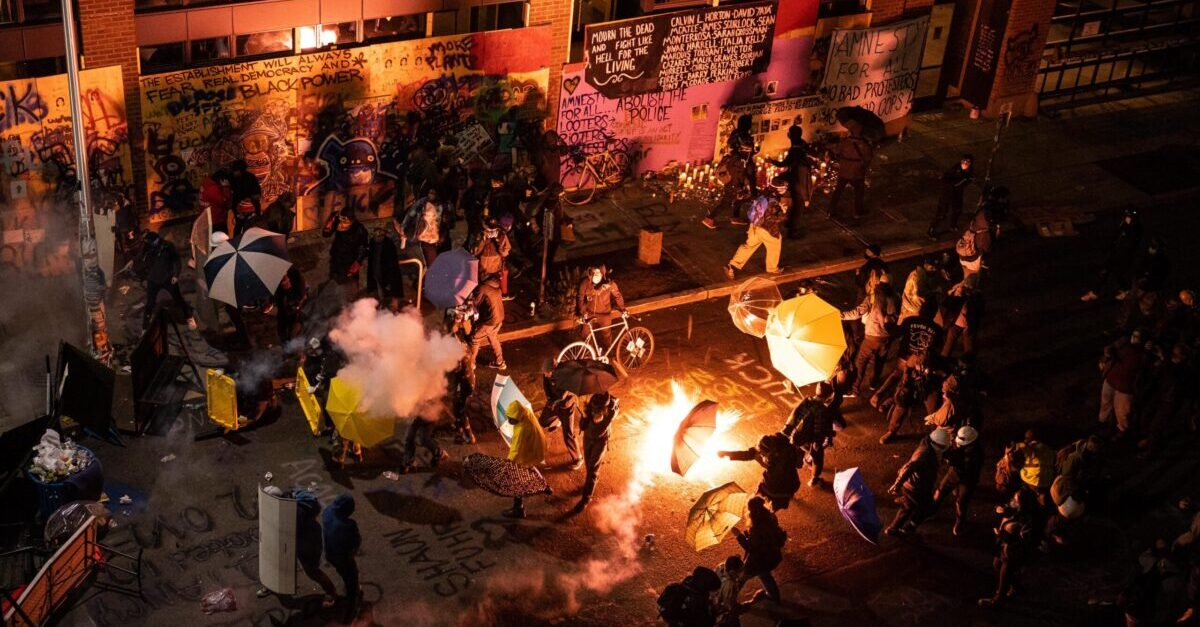 Seattle protesters clash violently with police during ongoing Black Lives Matter demonstrations following the death of George Floyd. (Photo by David Ryder/Getty Images)