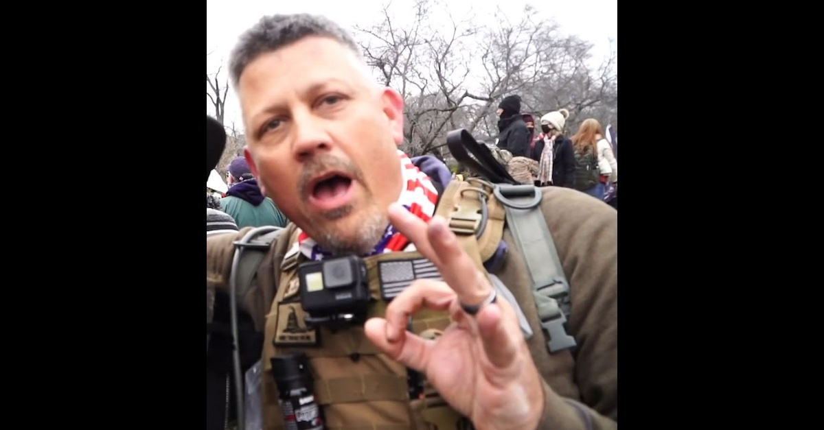 Proud Boy Chris Worrell appearing to give a white power sign at during the Capitol riot