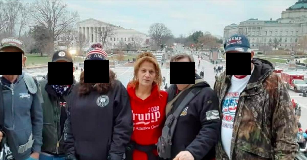 Sandy Pomeroy Weyer in red Trump 2020 sweatshirt