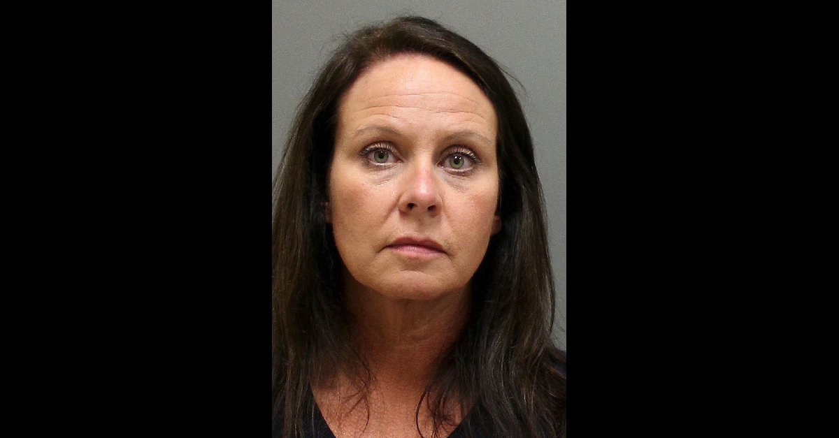 Carrie Witt appears in a mugshot