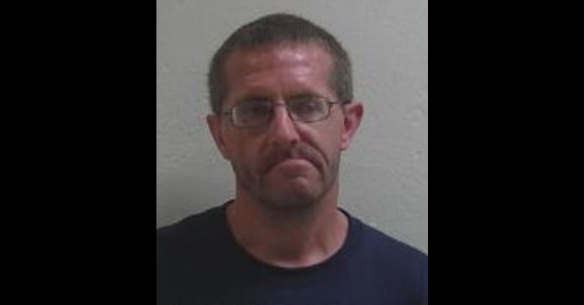 Robert West appears in a mugshot