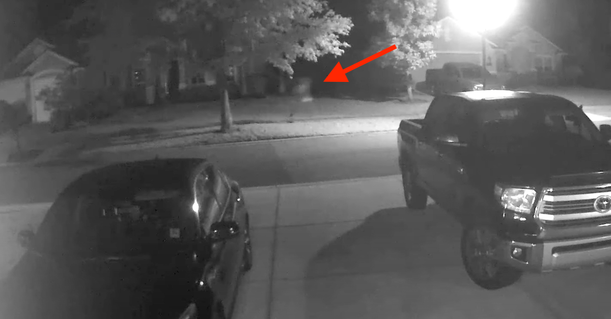 A still frame captured from a neighborhood surveillance camera shows what prosecutors and law enforcement authorities believe to be alleged murderer Aiden Fucci running from the location where he killed Tristyn Bailey.