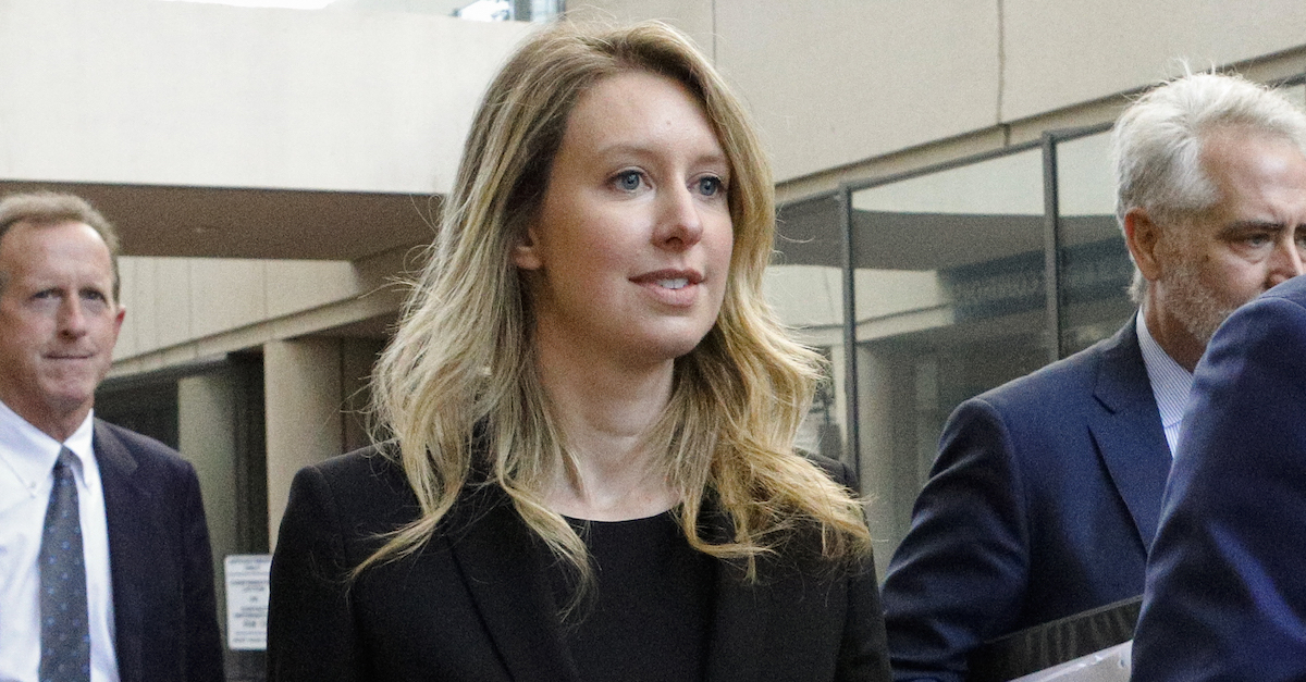 Former Theranos CEO Elizabeth Holmes leaves federal court with her legal team after a status hearing on July 17, 2019 in San Jose, Calif. (Photo by Kimberly White/Getty Images)