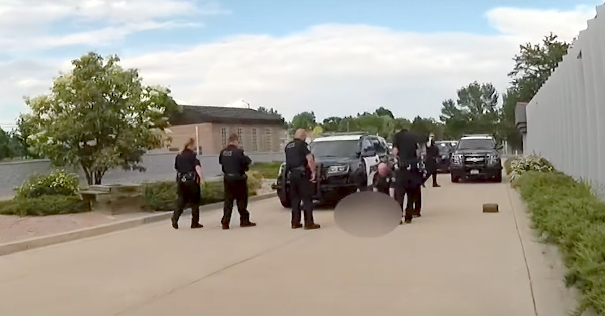 """Loveland, Colo. police swarm the area where the dog """"Herkimer"""" was shot."""