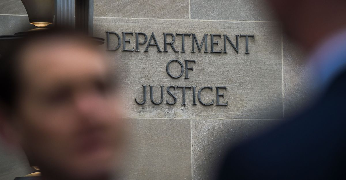 """Department of Justice"""" sign is seen on the wall of the US Department of Justice building in Washington"""