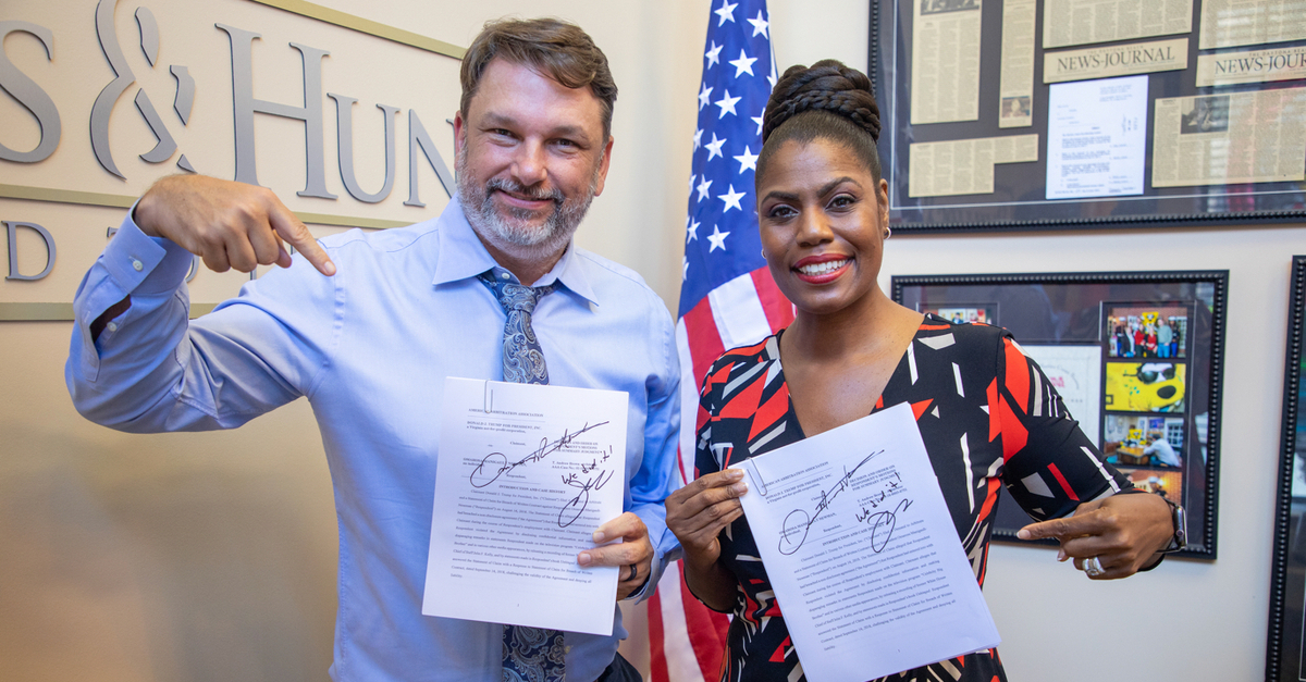 John M. Phillips and Omarosa Manigault Newman celebrate their win over Donald Trump