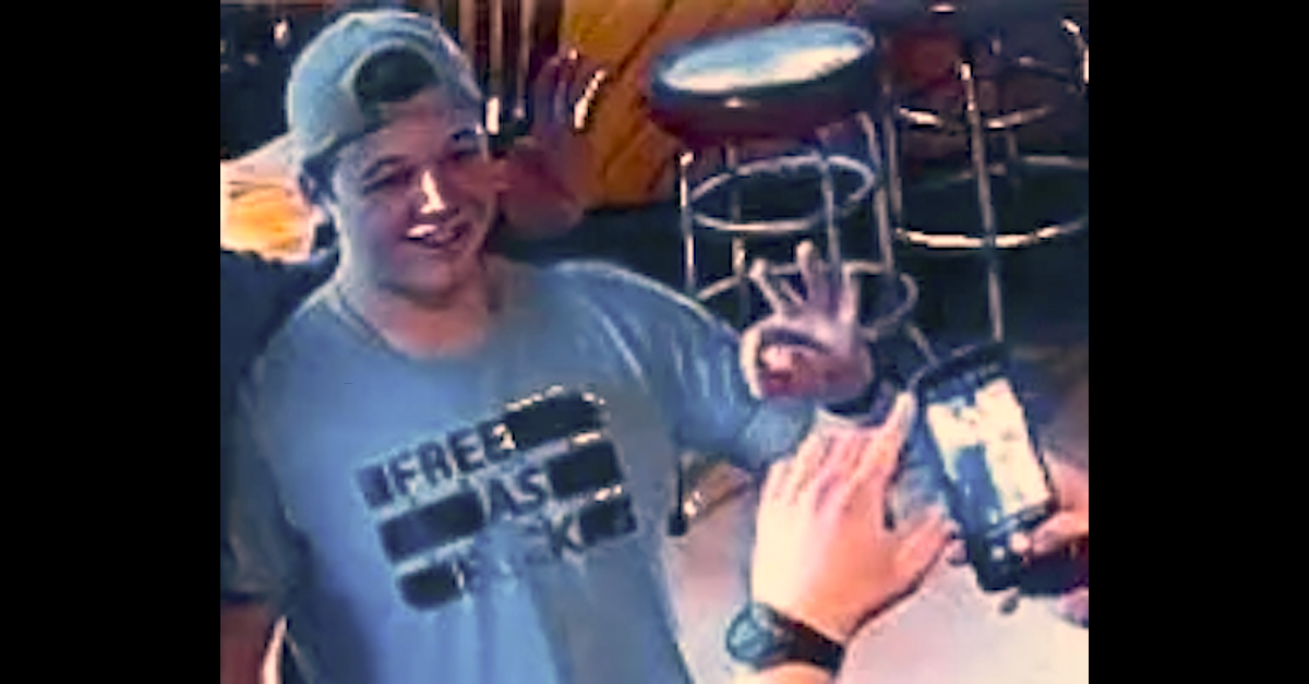 """Kyle Rittenhouse appears in an evidence photo making what prosecutors have argued is a """"white power"""" symbol."""