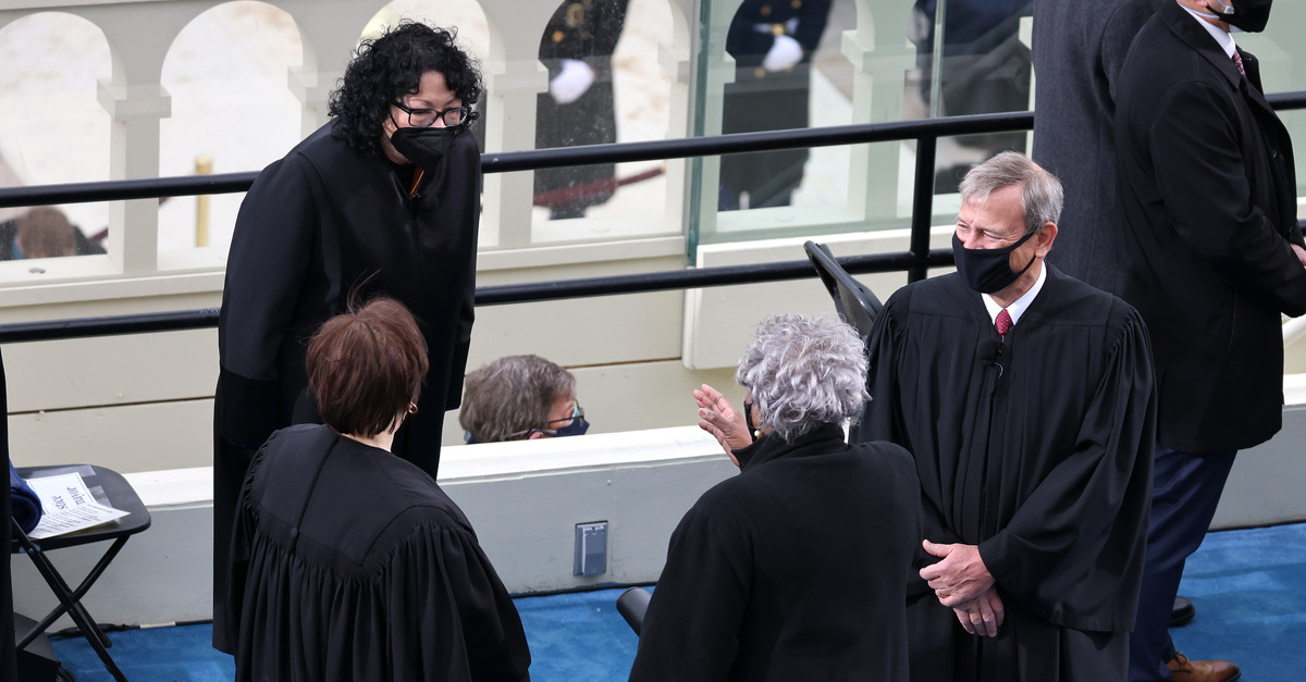 Supreme Court Chief Justice John Roberts (R) speaks with Supreme Court Associate Justices Sonia Sotomayor and Elena Kagan