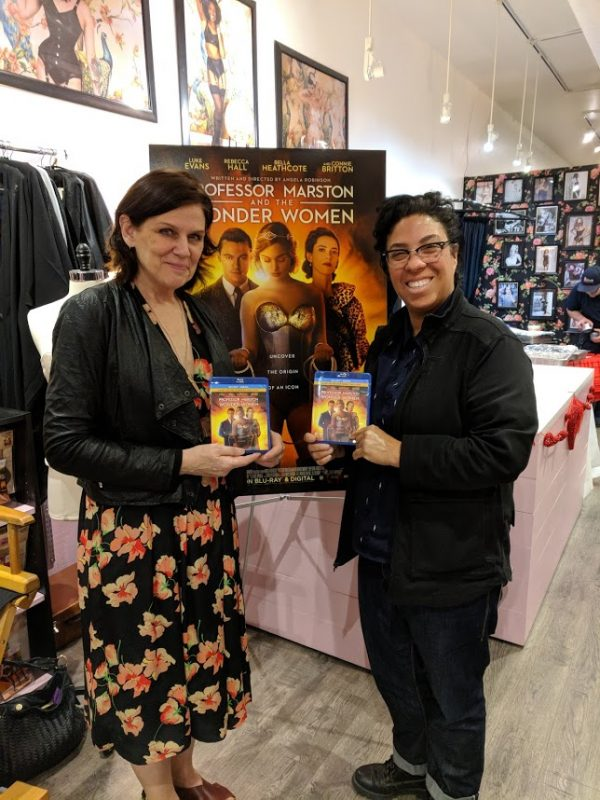 """image: Teresa Jusino Donna Maloney and Angela Robinson at the Blu-ray release party for """"Professor Marston and the Wonder Women"""" at What Katie Did in Burbank, CA"""