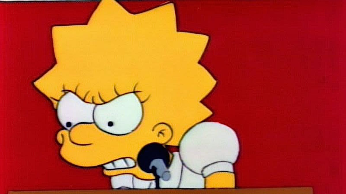 Lisa Simpson stands in front of a microphone looking furious at democracy.