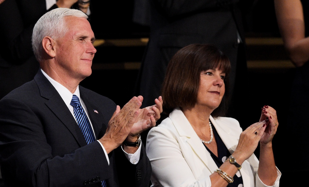 Republican vice presidential candidate Mike Pence stands with his wife Karen Pence on the fourth day of the Republican National Convention on July 21, 2016 at the Quicken Loans Arena in Cleveland, Ohio. Republican presidential candidate Donald Trump received the number of votes needed to secure the party's nomination. An estimated 50,000 people are expected in Cleveland, including hundreds of protesters and members of the media. The four-day Republican National Convention kicked off on July 18.