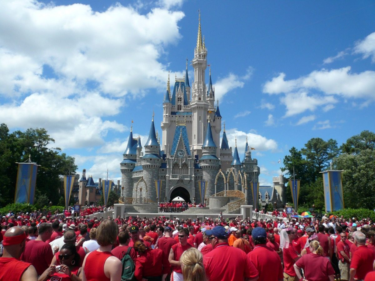 A sea of people in red shirts at Cinderella's Castle at Walt Disney World's Gay Days.