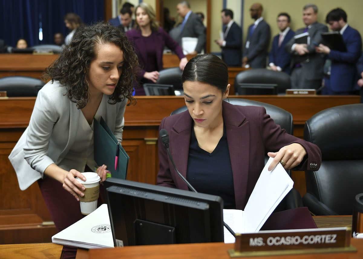 US Congresswoman Alexandria Ocasio-Cortez and her staff prepare to question Michael Cohen.