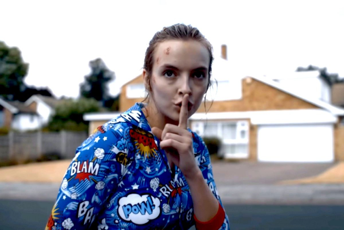 """Villanelle wears pajamas and makes """"shh"""" sign in Killing Eve."""
