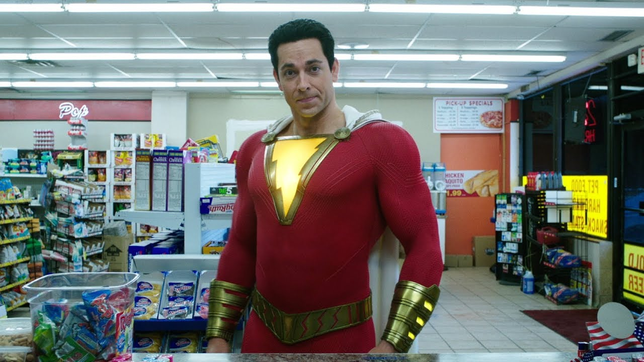 Shazam standing in front of the counter at a convenience store.