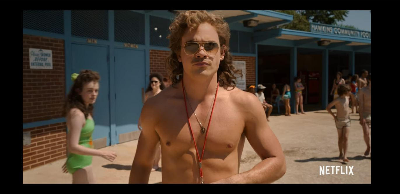 billy hargrove (dacre montgomery) hits the pools in stranger things.
