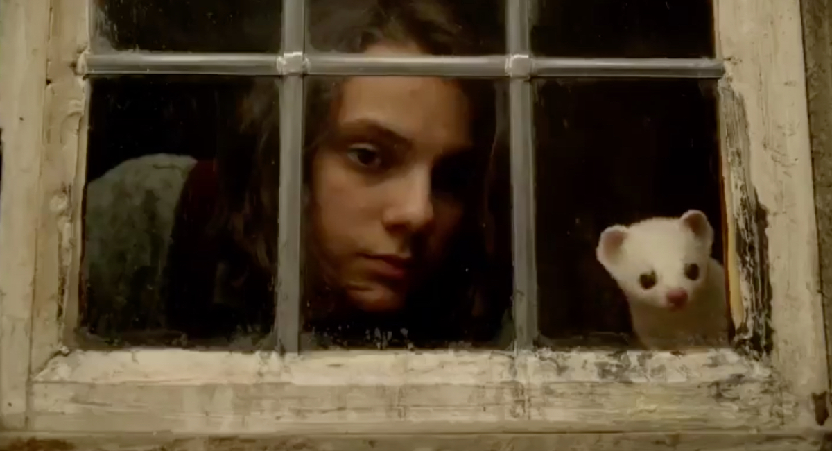 Lyra (Dafne Keen) and Pantalaimon try to stay one step ahead of the villains in His Dark Materials.