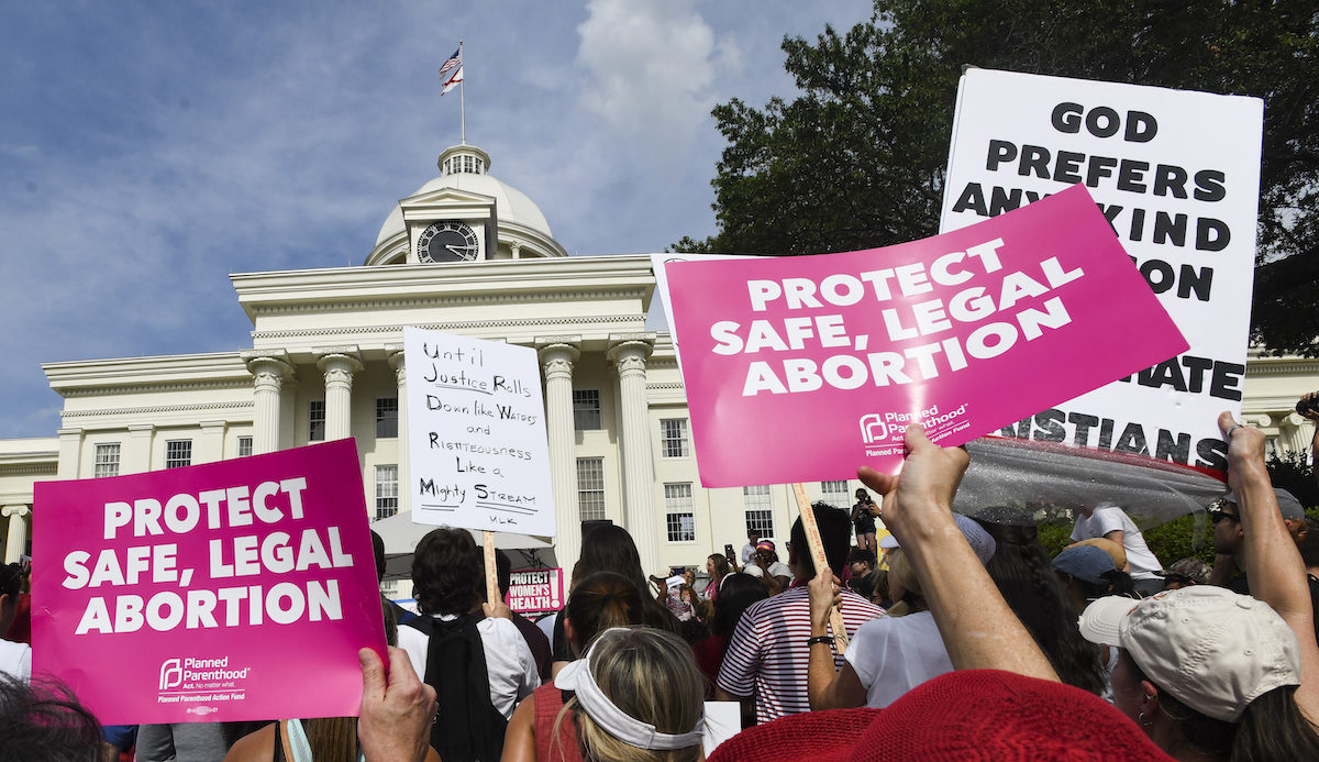 Protestors participate in a rally against one of the nation's most restrictive bans on abortions