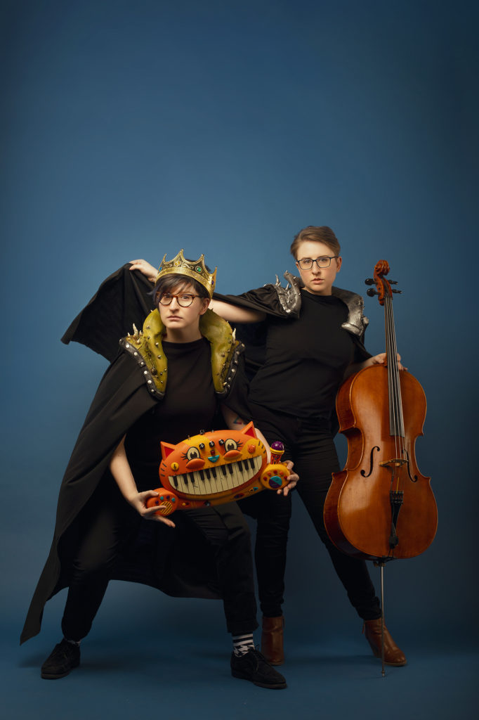 ser Malena-Webber and Aubrey Turner of the Doubleclicks dressed in capes and crowns.
