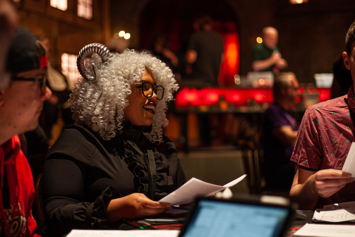 A black woman plays D&D in cosplay.