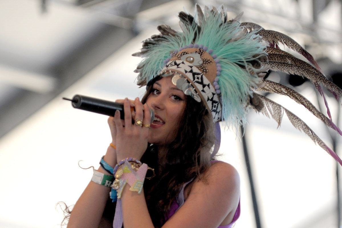 Singer Eliza Doolittle performs at Coachella in an elaborate feathered headdress.