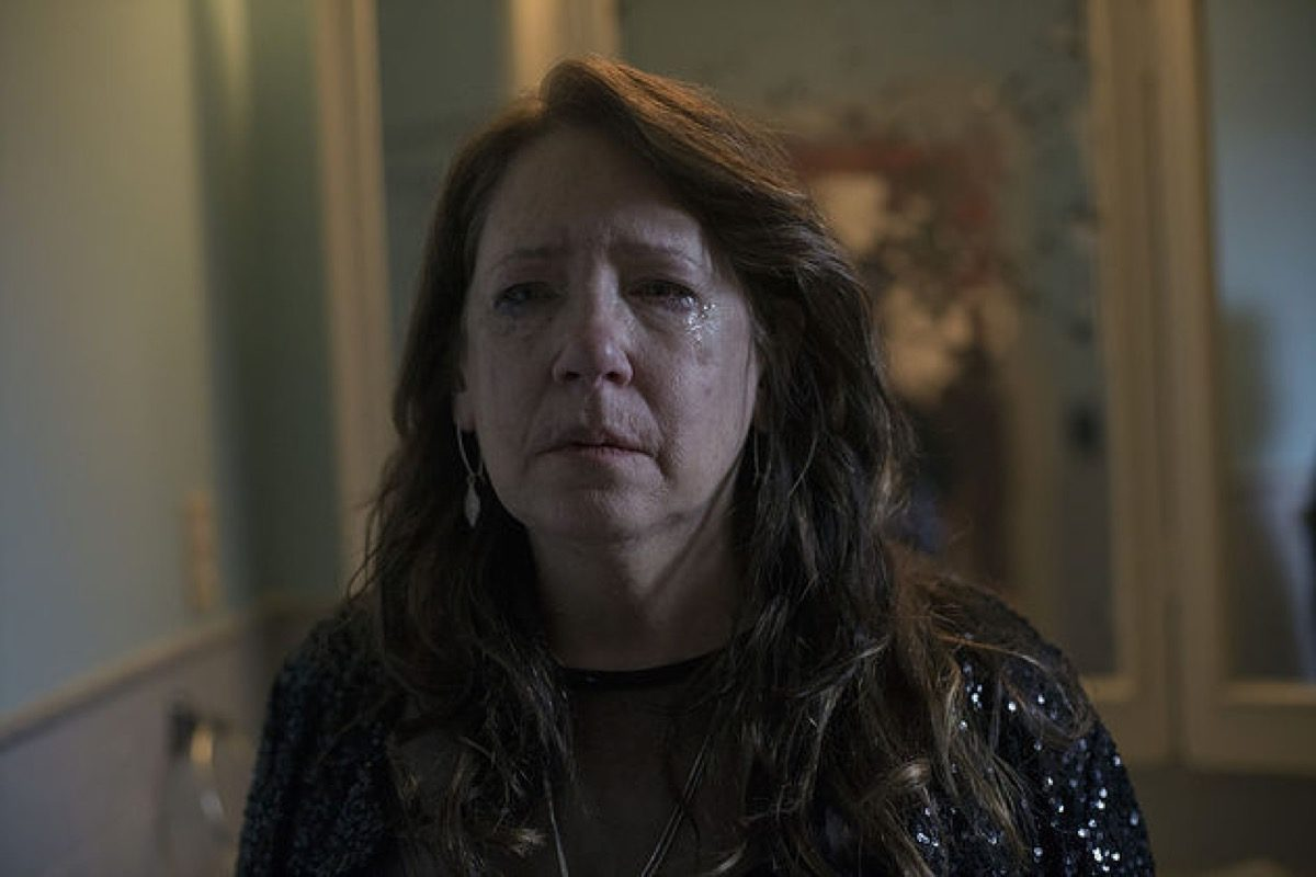 Aunt Lydia's tear-stained face in Hulu's The Handmaid's Tale season 3.