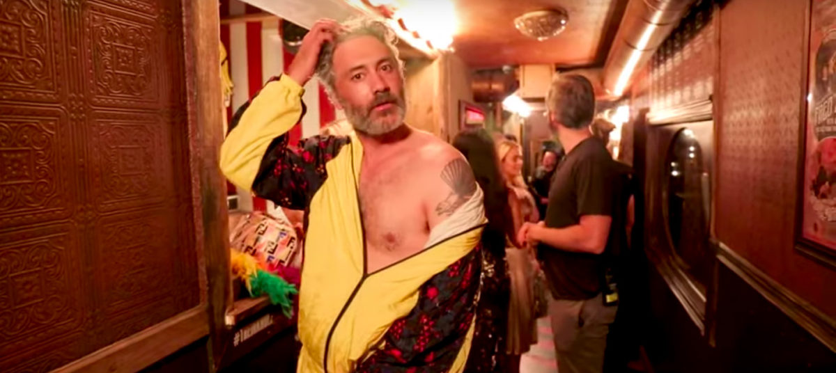 Taika Waititi with an off the shoulder look