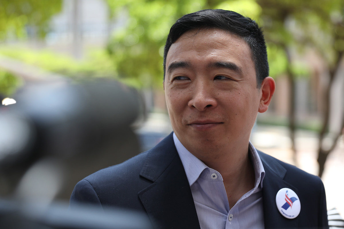 Andrew Yang speaks to media outside.