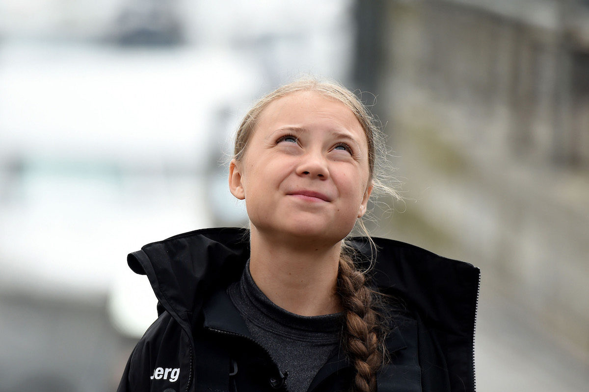 Teenage climate activist Greta Thunberg looks up at the sky.