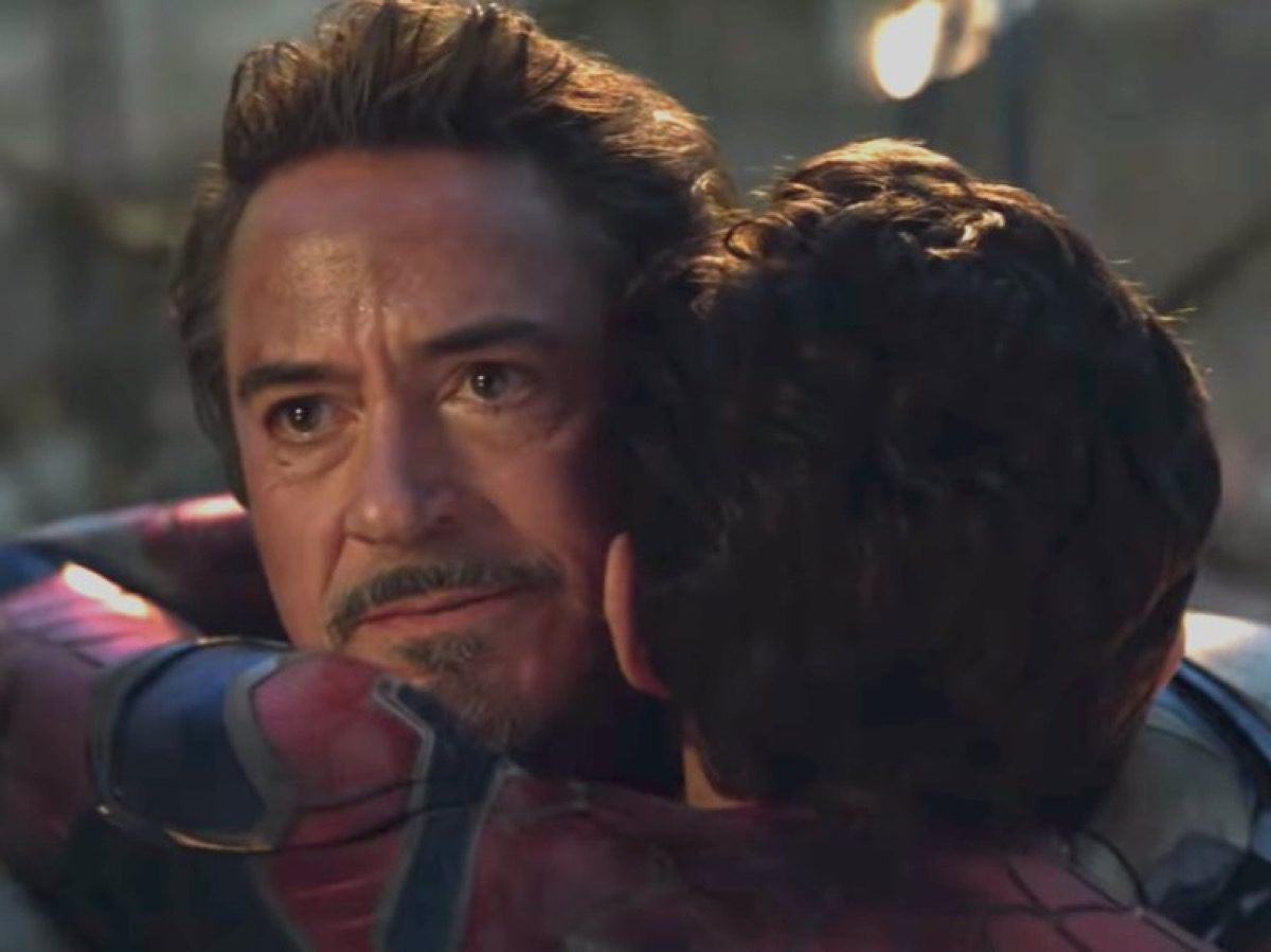 Tony Stark hugs Peter Parker in Marvel's Avengers: Endgame.
