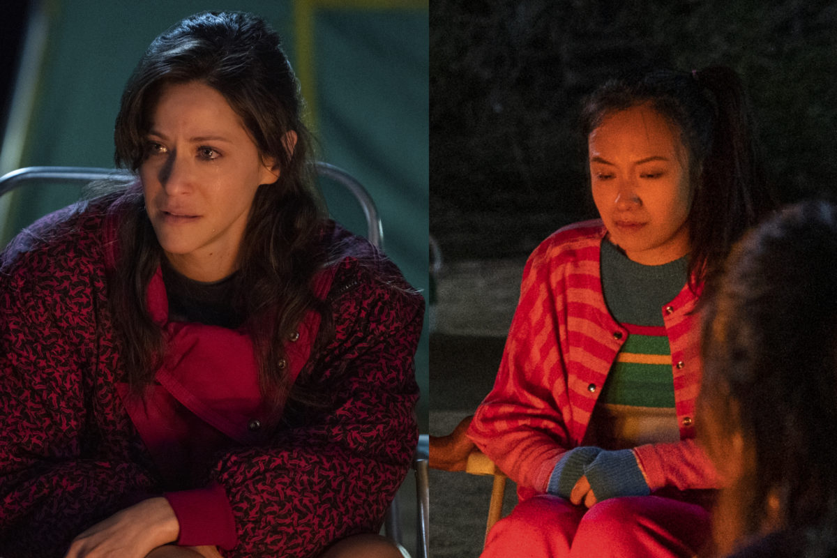 Melrose and Jenny sit around a campfire on Netflix's GLOW.