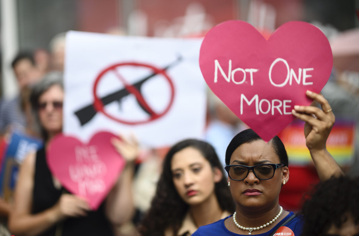 Protestors take part in a rally of Moms against gun violence.