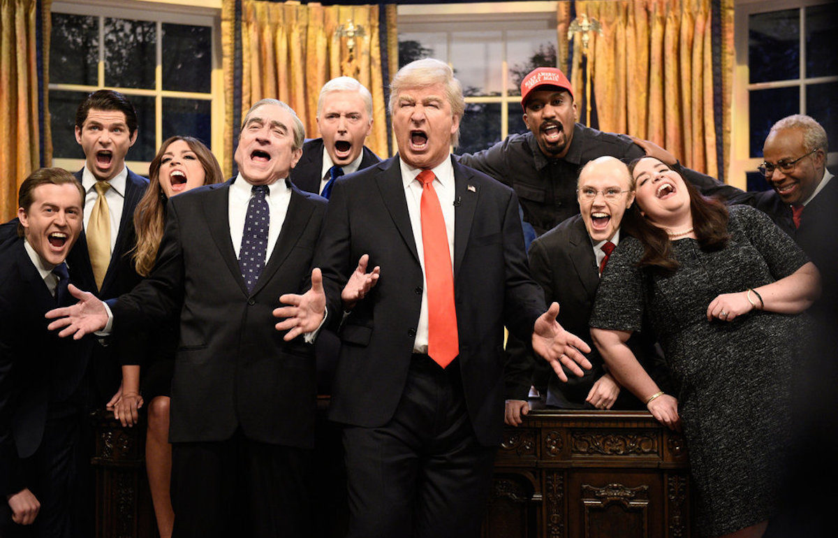 The cast of SNL dressed up as the members of the Trump administration, singing.
