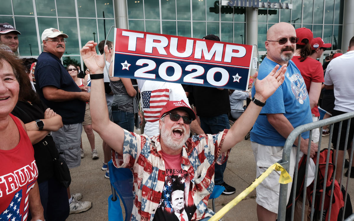 Donald Trump supporters gather outside of an arena