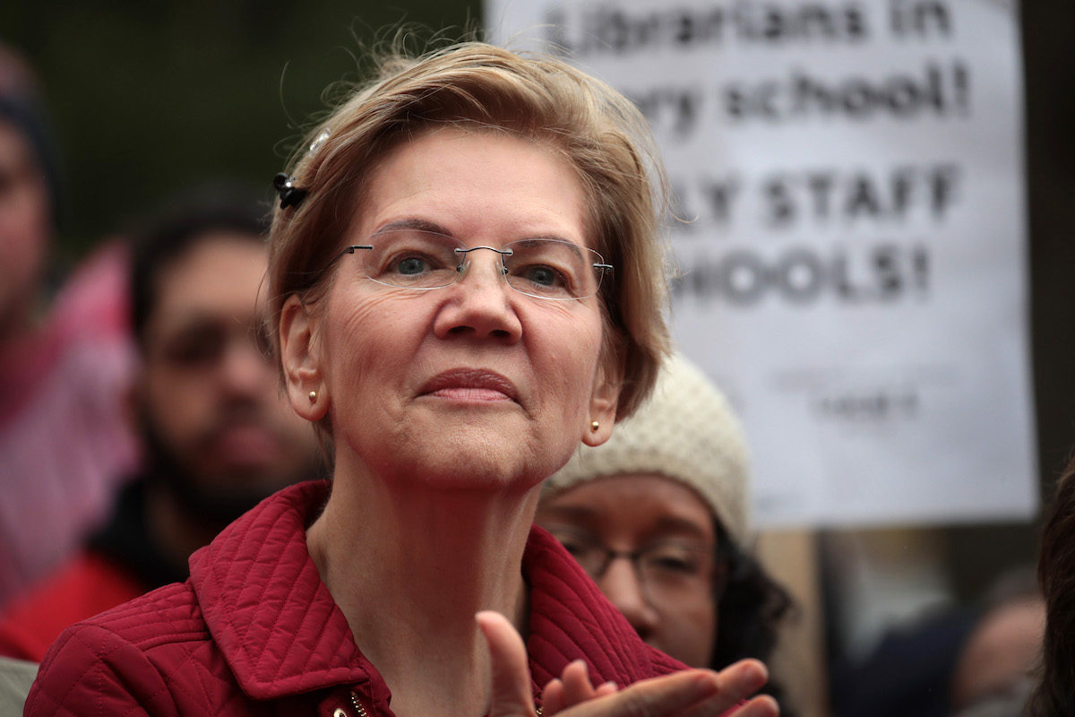 Elizabeth Warren clapping at a rally for striking teachers.