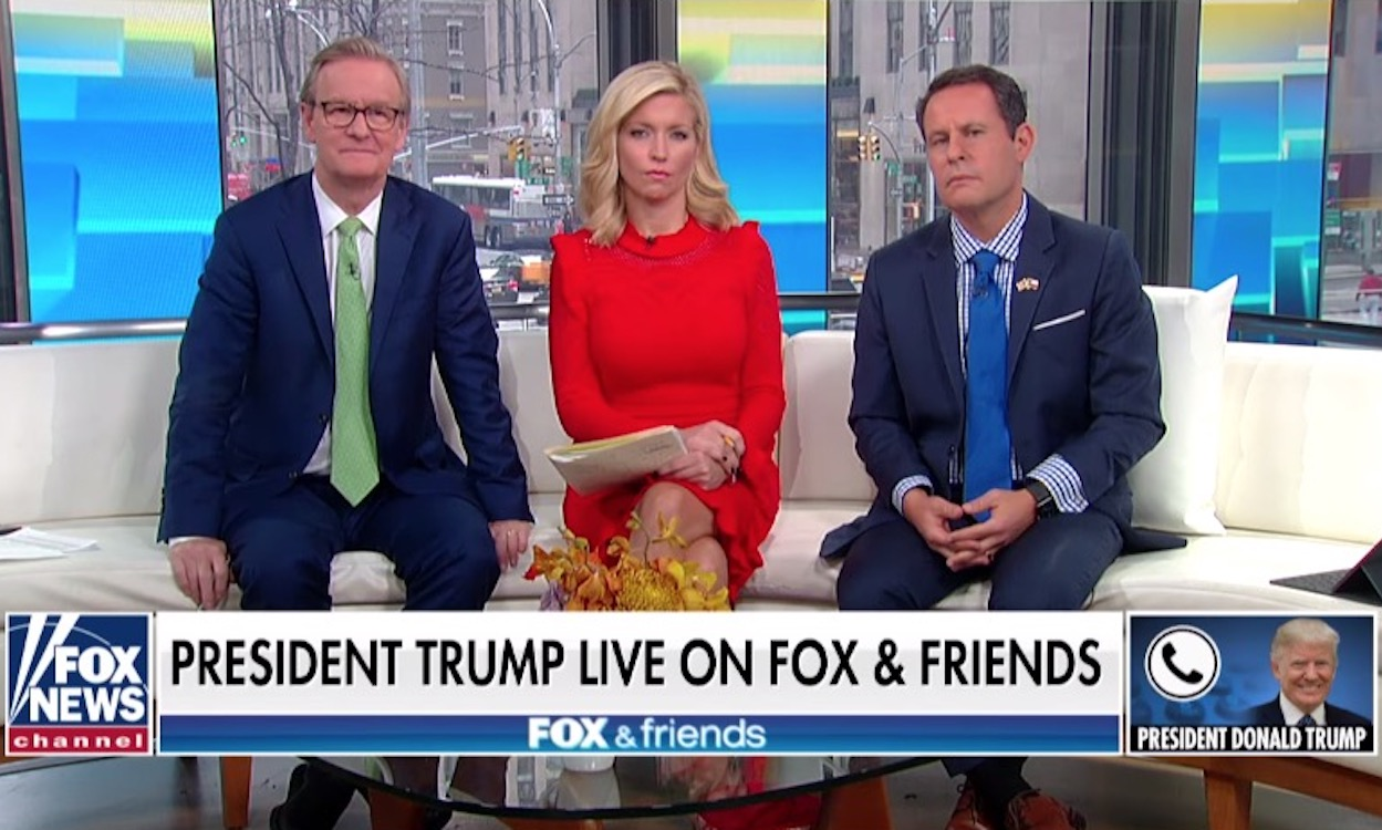 Fox & Friends hosts look uncomfortable as Trump rants over the phone.