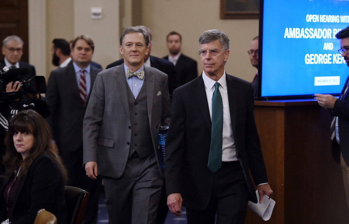 George Kent, the deputy assistant secretary of state for European and Eurasian Affairs and Ukrainian Ambassador Bill Taylor(front), the top diplomat in the US embassy in Ukraine arrive in the impeachment inquiry into US President Donald Trump in Washington, DC