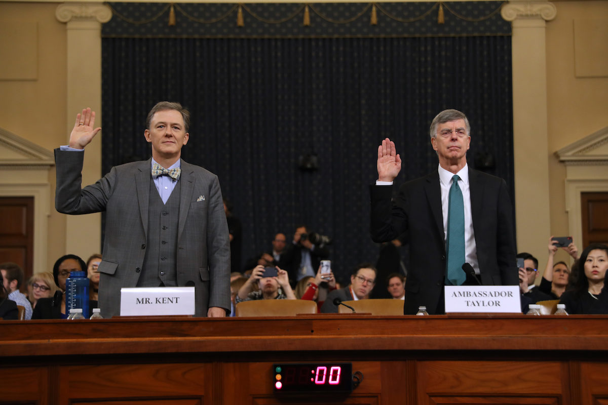 Deputy Assistant Secretary for European and Eurasian Affairs George P. Kent (L) and top U.S. diplomat in Ukraine William B. Taylor Jr. are sworn in before testifying before the House Intelligence Committee