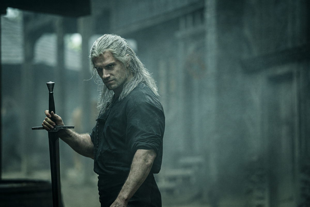 Henry Cavil scowls in a dark city in the witcher