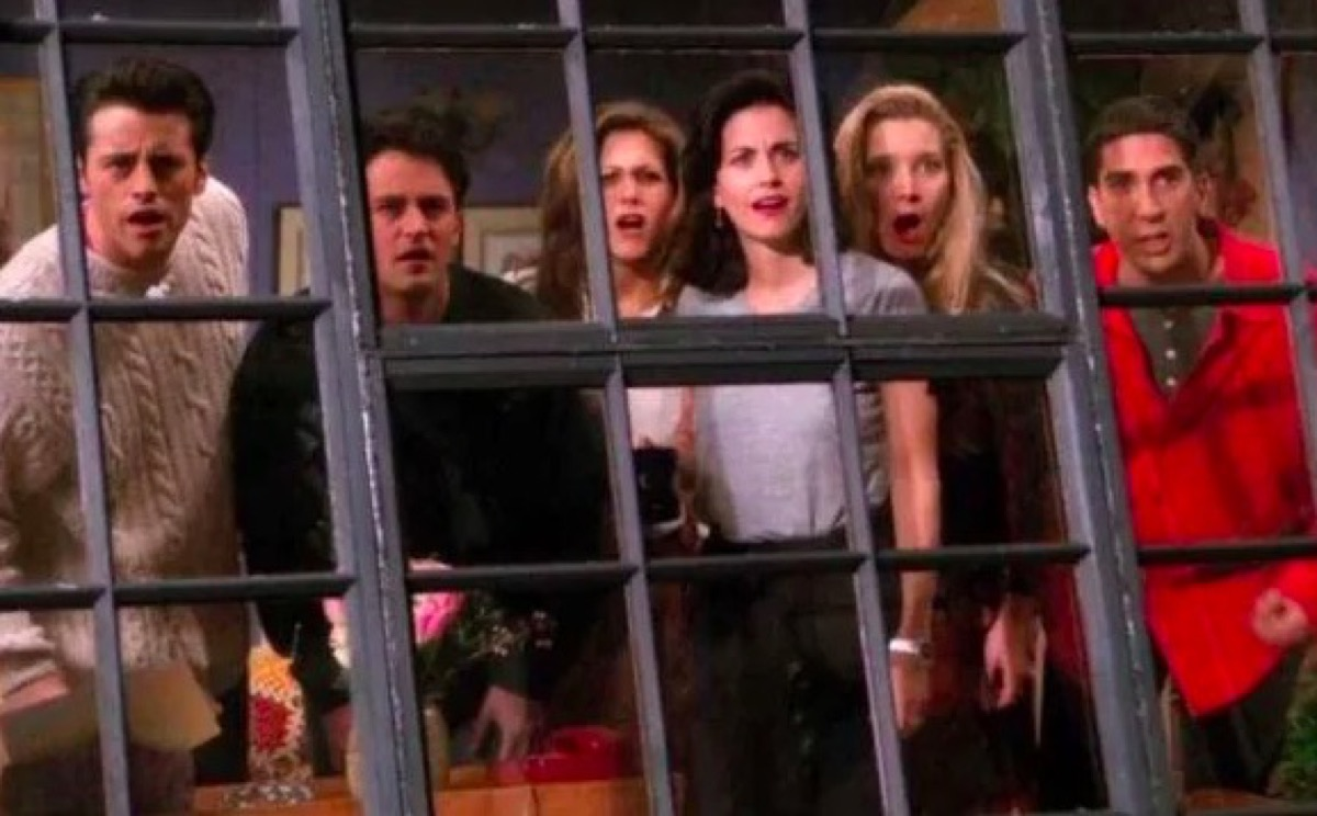 The cast of the show Friends looking out their apartment window.