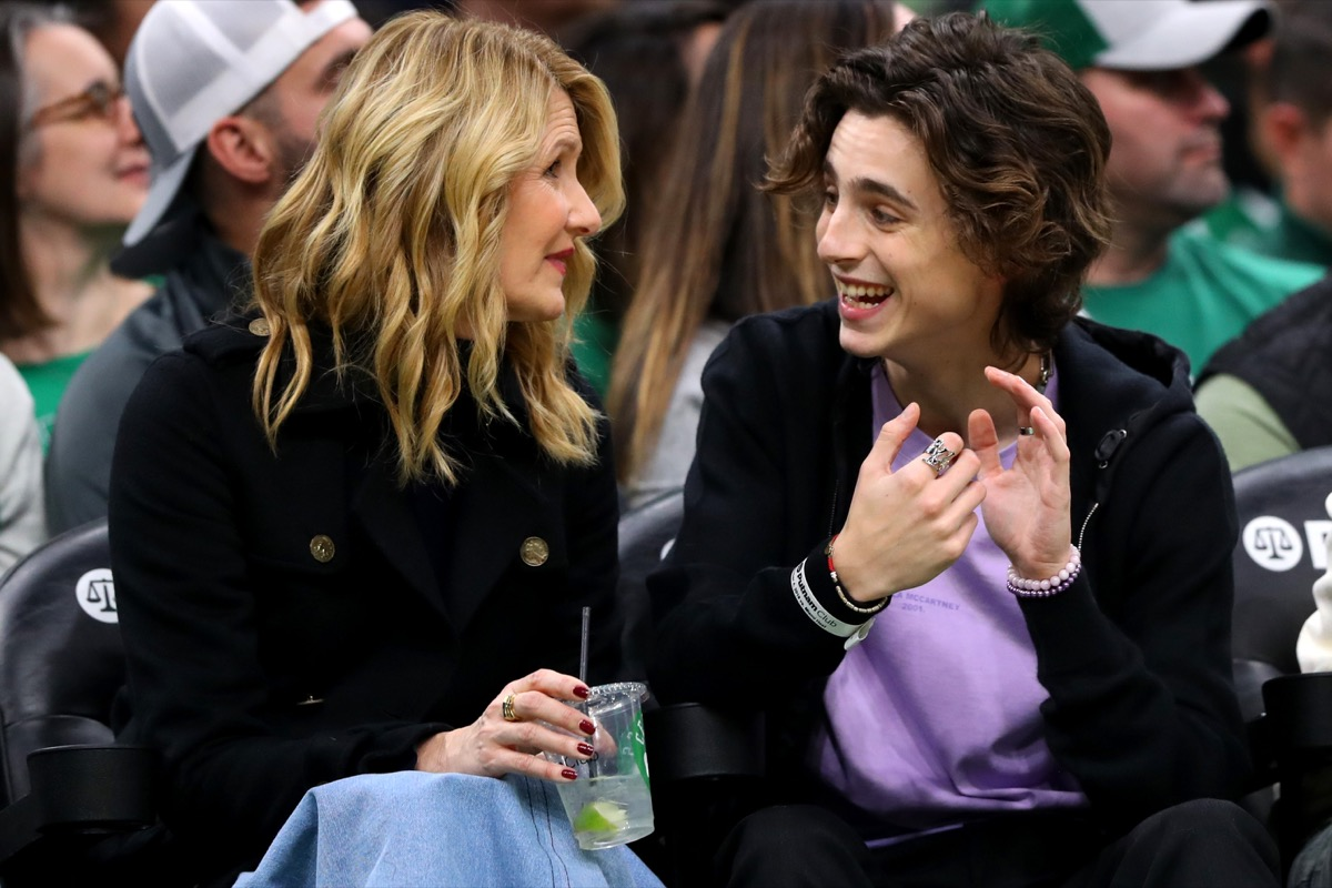 Actress Laura Dern and actor Timothée Chalamet sit courtside during the second half of the game between the Boston Celtics and the Miami Heat at TD Garden on December 04, 2019 in Boston, Massachusetts.