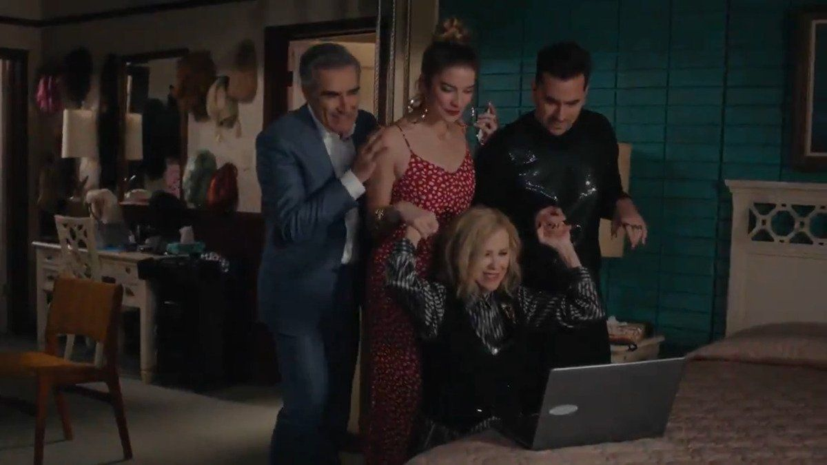 the rose family gathers around laptop