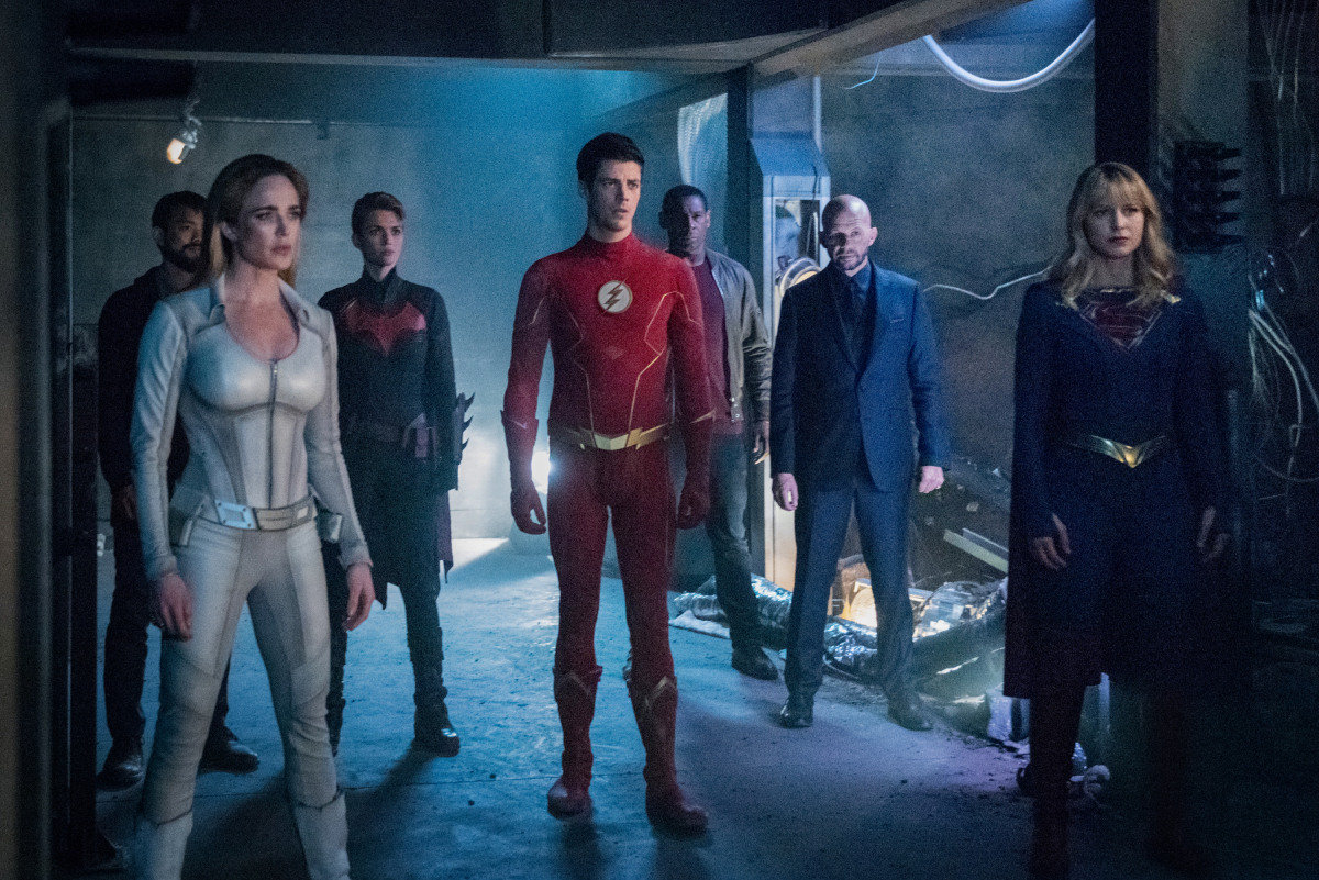 """Arrow -- """"Crisis on Infinite Earths: Part Four"""" -- Image Number: AR808B_0399r.jpg -- Pictured (L-R): Osric Chau as Ryan Choi, Caity Lotz as Sara Lance/White Canary, Ruby Rose as Kate Kane/Batwoman, Grant Gustin as The Flash, David Harewood as Hank Henshaw/J'onn J'onzz, Jon Cryer as Lex Luthor and Melissa Benoist as Kara/Supergirl -- Photo: Dean Buscher/The CW -- © 2019 The CW Network, LLC. All Rights Reserved."""