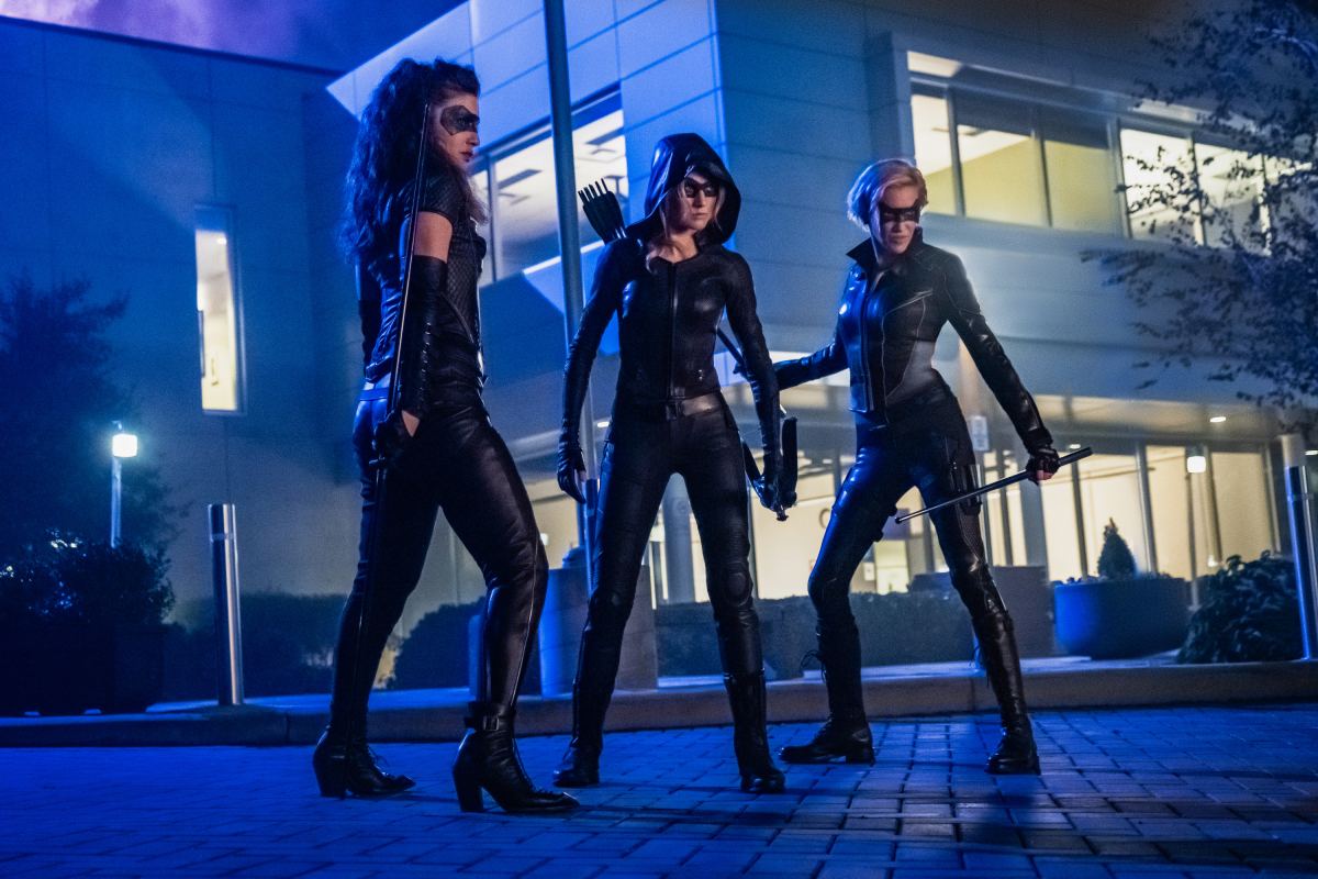 """Arrow -- """"Green Arrow & The Canaries"""" -- Image Number: AR809a_0094r.jpg -- Pictured (L-R): Juliana Harkavy as Dinah Drake/Black Canary, Katherine McNamara as Mia and Katie Cassidy as Laurel Lance/Black Siren -- Photo: Katie Yu/The CW -- © 2020 The CW Network, LLC. All Rights Reserved."""