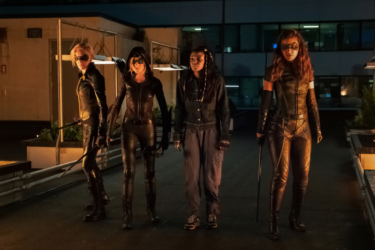 """Arrow -- """"Green Arrow & The Canaries"""" -- Image Number: AR809a_0263r.jpg -- Pictured (L-R): Katie Cassidy as Laurel Lance/Black Siren, Katherine McNamara as Mia, Raigan Harris as Bianca Bertinelli and Juliana Harkavy as Dinah Drake/Black Canary -- Photo: Katie Yu/The CW -- © 2020 The CW Network, LLC. All Rights Reserved."""