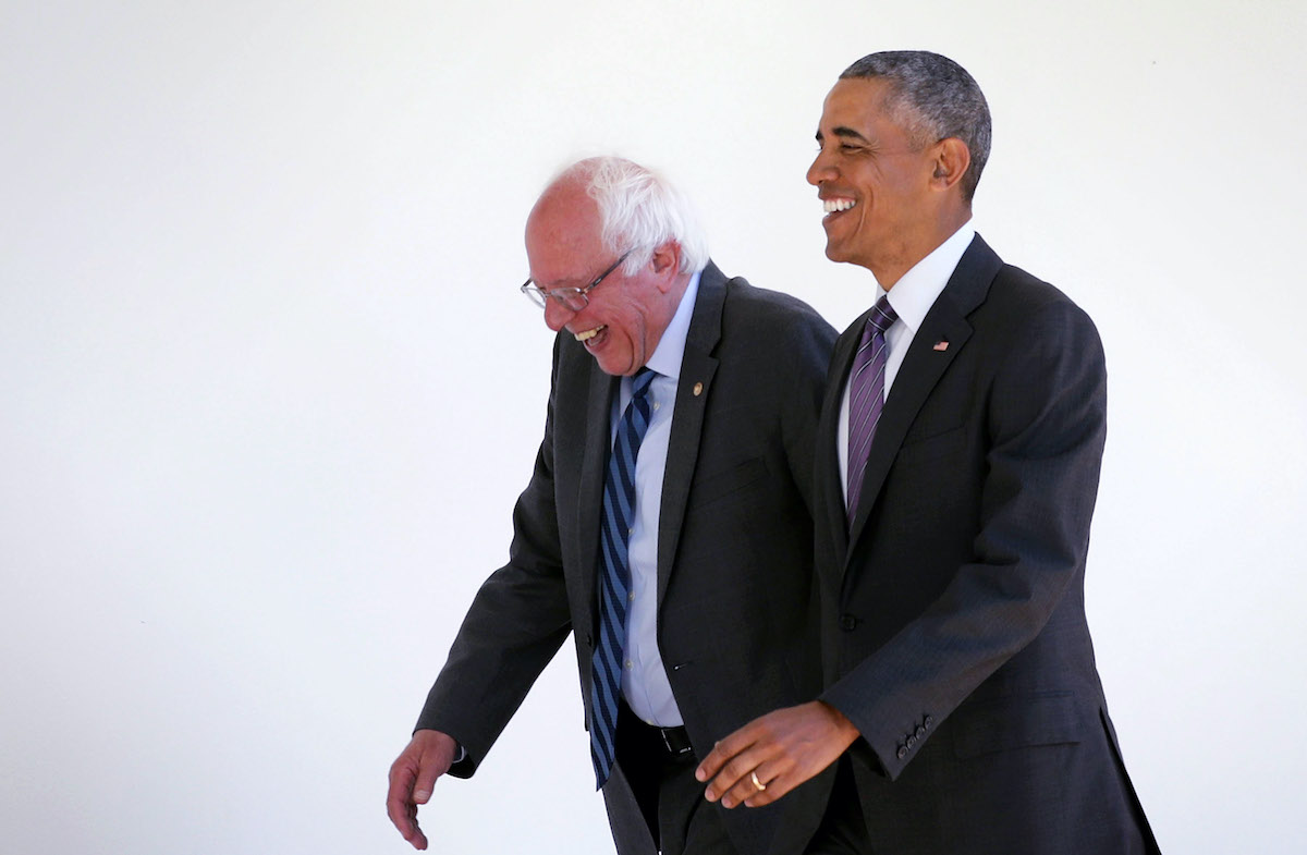 Bernie Sanders (I-VT) (L) walks with President Barack Obama (R) through the Colonnade as he arrives at the White House for an Oval Office meeting
