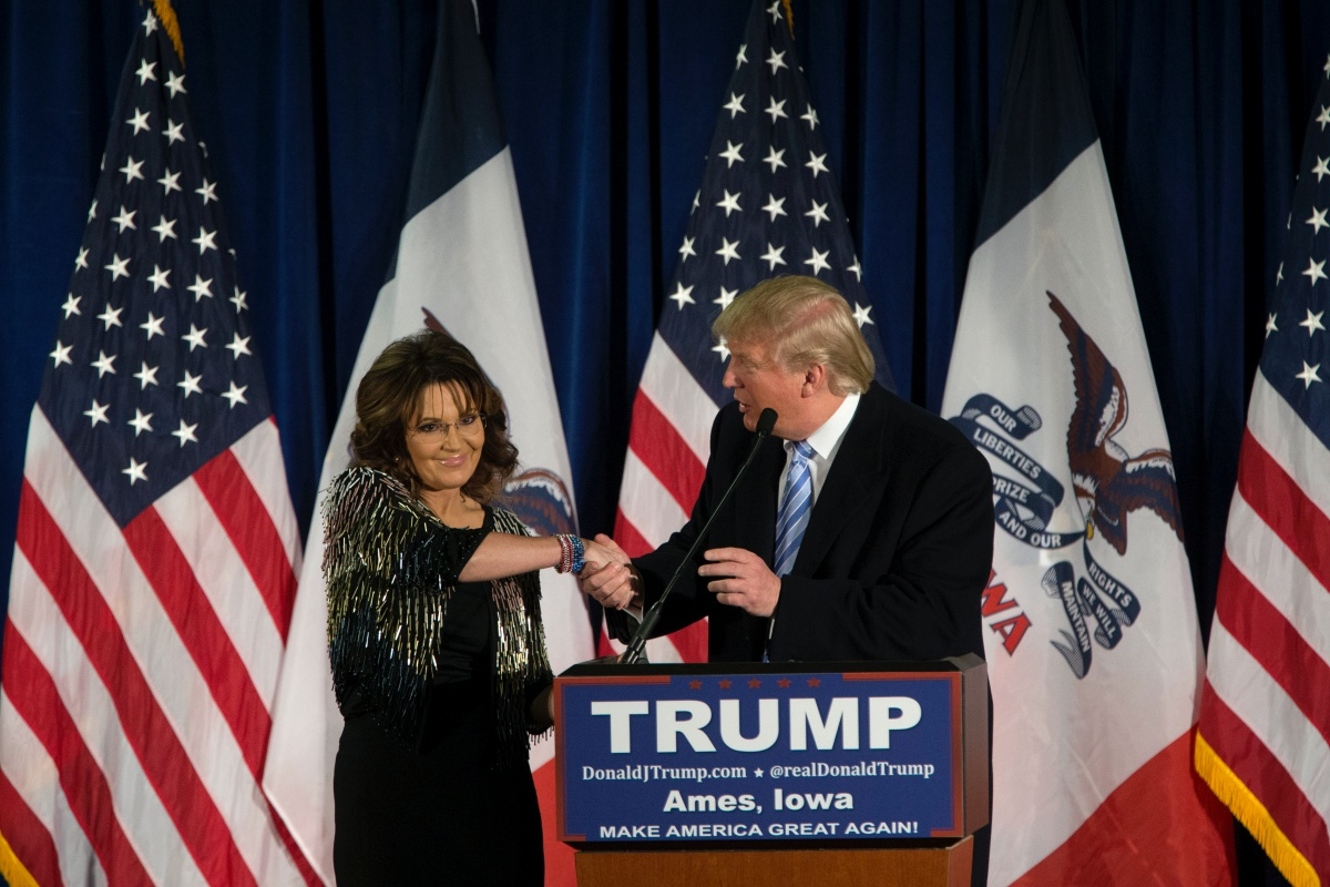 Republican presidential candidate Donald Trump shakes hands with former Alaska Gov. Sarah Palin at Hansen Agriculture Student Learning Center at Iowa State University on January 19, 2016 in Ames, IA. Trump received Palin's endorsement at the event. (Photo by Aaron P. Bernstein/Getty Images)
